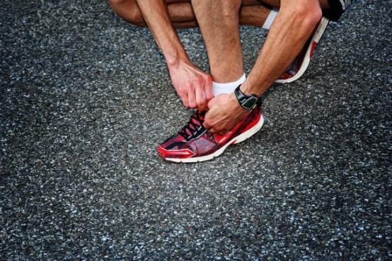 A runner preparing his shoe for the upcoming semi marathon